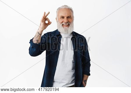 Alright. Handsome Senior Man Laughing, Showing Okay Ok Sign And Nod In Approval, Praise Good Work, M