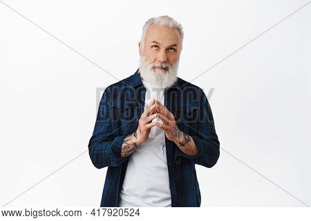 Thoughful Old Stylish Man Steeple Fingers, Looking Up And Thinking, Making Plan, Scheming Like Evil