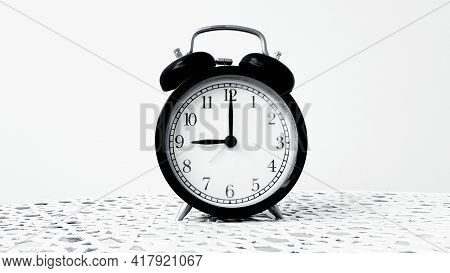 Vintage Clock On Table Isolated On White Background In Monochrome Or Black And White Tone With Copy