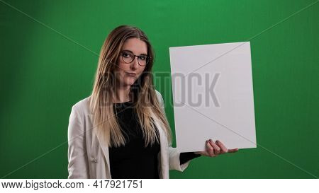 Young Pretty Woman Holds A Dummy Sign And Points To It - Studio Photography