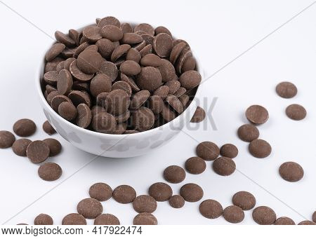 Tempered Chocolate Confectionery Concept. Bowl Full Of Chocolate. Chocolate Drops And Chocolate Piec