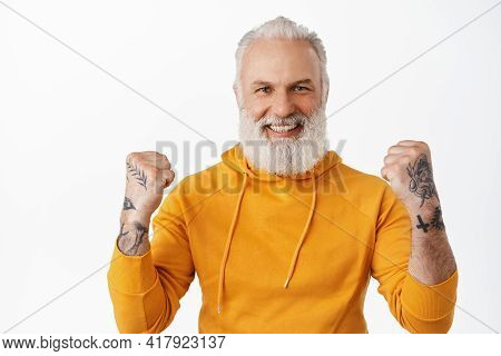 Yes I Did It. Satisfied Hipster Senior Man Celebrating Victory, Clench Fists With Tattoos And Smilin