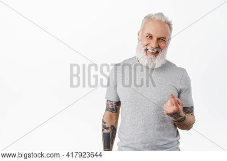 Come Closer. Happy Handsome Old Man With Tattoos Beckon To Approach, Flick Finger, Smiling And Laugh