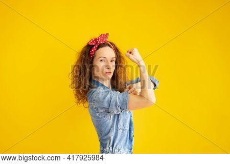 Retro Portrait Of Strong Woman Against Yellow Backgrond.