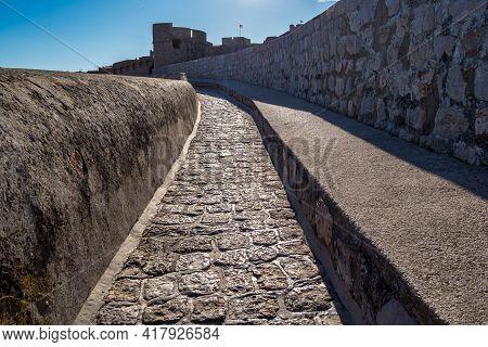 Walk On The Ancient, Defensive City Wall In Dubrovnik, Croatia At The Dalmatian Coast Of The Adriati
