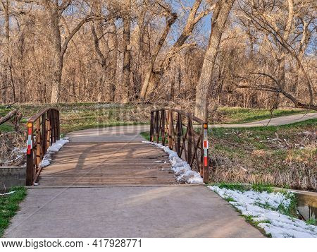 one of many numerous bike trails in Fort Collins area in northern Colorado,  recreation and commuting concept in early spring scenery