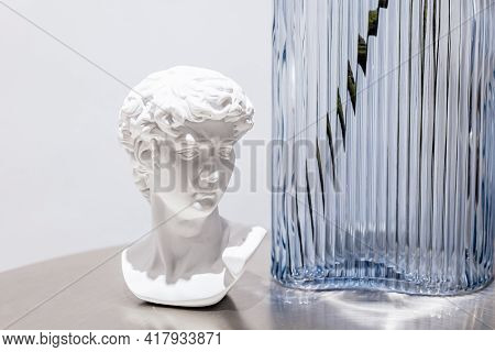 Stylish Gypsum Statue Of David Bust In Living Room Or Cafe Interior. Michelangelo David Sculpture Pl