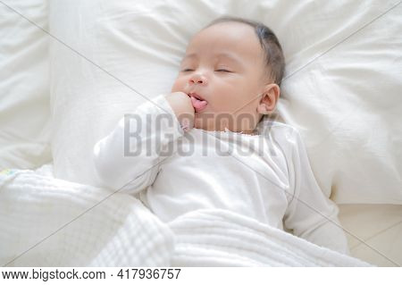A Newly Born Bastard Is Wrapped In A White Cloth And Sleeps On A Bed