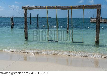 Swing Over Turquoise Water At Isla Mujeres, Cancun, Mexico