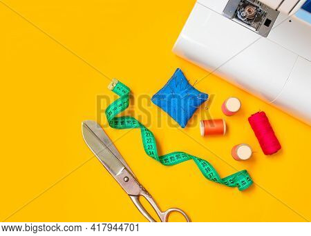 Sewing Accessories. Composition With Threads And Sewing Accessories On Yellow Background. Workplace