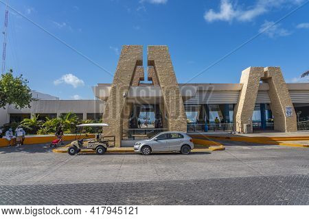 Isla Mujeres, Mexico -march 12.2021: The Ferry Terminal On Isla Mujeres, Cancun With A Golf Car Infr