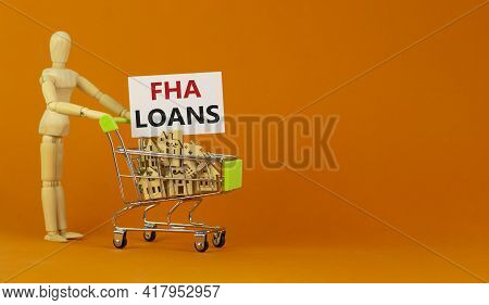 Fha Loans Symbol. Miniature Shopping Cart With Wooden Houses, Words Fha Loans, Federal Housing Admin