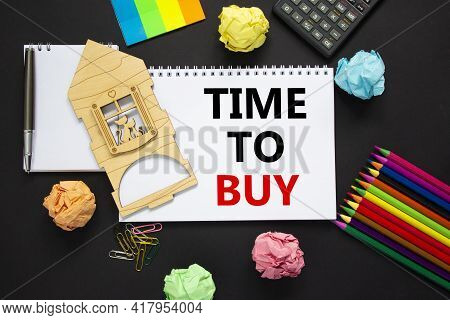 Time To Buy Real Estate Symbol. White Note With Words 'time To Buy' On Beautiful Black Background, M