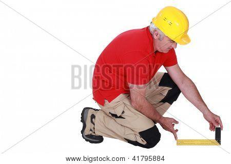 Middle-aged carpenter using set-square