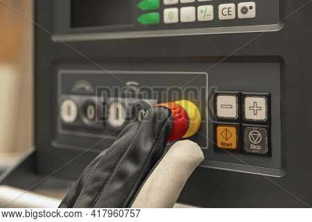 Emergency Shutdown Button In Production. The Cnc Operator Presses The Emergency Button On The Contro