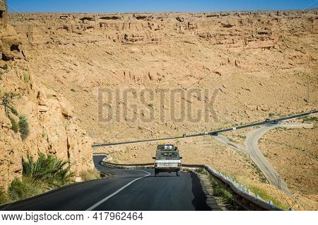 Madkhal Meski, Morocco - April 12, 2015. Silver Vintage Off Road Car Going On The New Tar Road Aroun