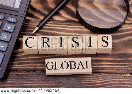 Crisis Word On Wooden Cubes. Economical Fall Business Crisis Concept. High Quality Photo