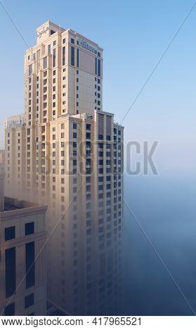 Dubai, Uae - 02.13.2021: Hilton Jbr Hotel Skyscraper Building In Fog, Scenic Aerial Shot At Jumeirah