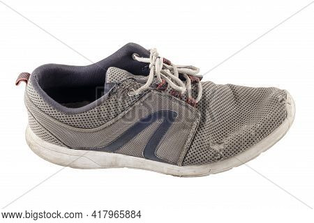 Side View Of One Worn Out Sneaker Isolated On White Background