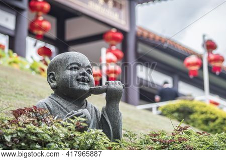 Jan 12 2018 Cotia Sp Brazil Smiling Little Buda Statue And The Entrance Of The Temple Is Blurry By T