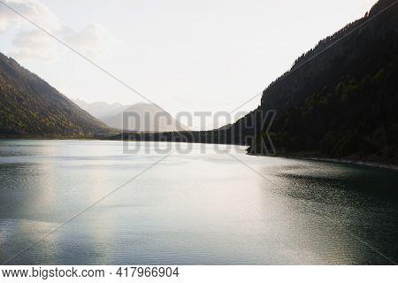 Alpine Mountain Panorama At Sylvenstein Stausee Water Reservoir Dam Lake Isar Valley Upper Bavaria,
