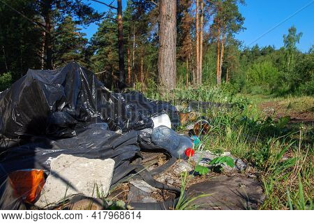 Unauthorized Garbage Dump In The Forest, Pile Of Household Waste