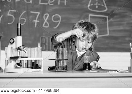 Little Kid Learning Chemistry In School Laboratory. Biology School Laboratory Equipment. Little Boy