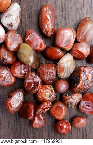 South Onyx Heap Up Jewel Stones Texture On Brown Varnished Wood Background
