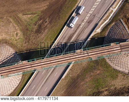 Gasoline truck Oil trailer, truck on highway driving along the road. Tank truck at work aerial view above. highway intersection junction