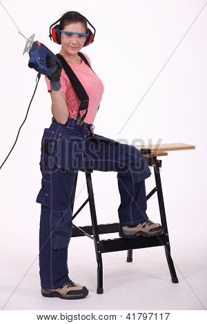 A female carpenter with a jigsaw.