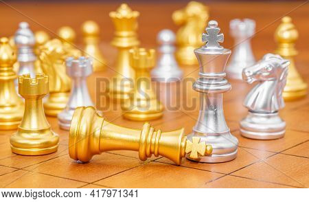 King Chess Piece Stand On Wood Chessboard