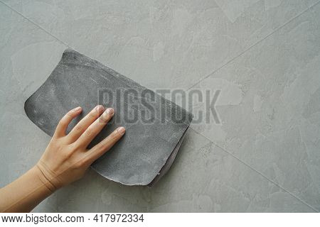 Close Up Worker Hand Use Sandpaper For Smooth Cement Wall Texture