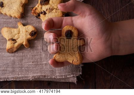 Homemade Gluten-free, Lactose-free Cookies Without Sugar With Raisins And Chocolate On Dark Brown Wo