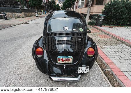 Alanya, Turkey - April 12 2021:    Vintage Black Car Volkswagen Beetle On The Background Of A City S