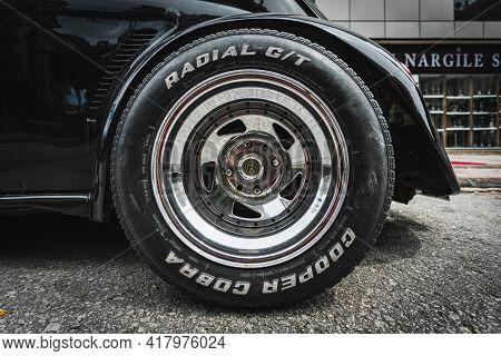 Alanya, Turkey - April 12 2021:    Vintage Black Car Volkswagen Beetle. Close-up Of The Bumper, Allo