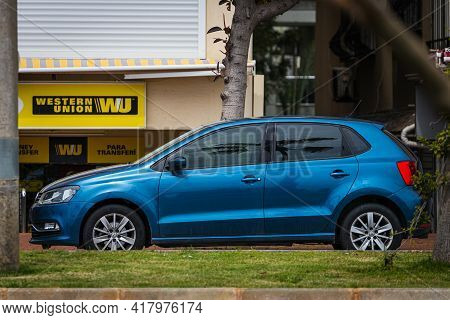 Alanya, Turkey - April 12 2021:   Blue Volkswagen Polo  Is Parked  On The Street On A Warm Summer Da