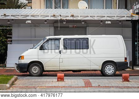 Alanya, Turkey - April 12 2021:   White Volkswagen Transporter  Is Parked  On The Street On A Warm S
