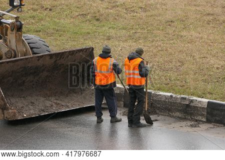 Its A Clean City. People, Workers Clean The Roads. Roadworks And Road Cleaning. High Quality Photo