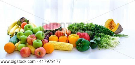 Assorted Fresh Ripe Fruits And Vegetables On The Table At White Curtain Background, Food Concept Bac