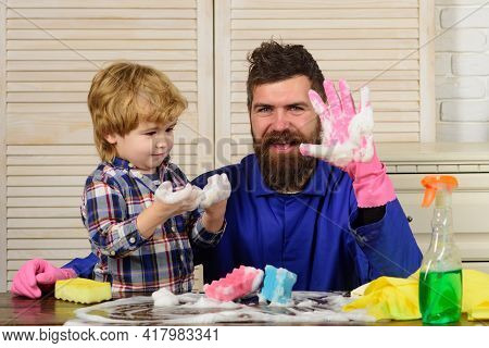 Dad And Son With Cleaning Supplies. Father And Child Boy Ready To Do Housework Together. Funny House