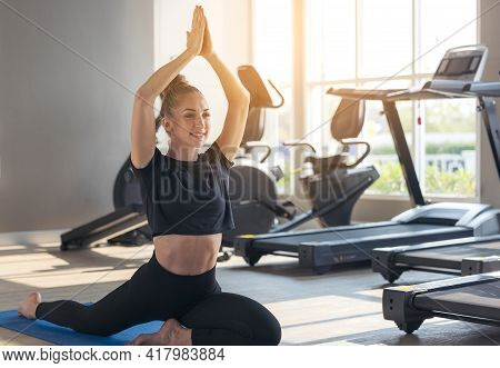 Beautiful Fit Woman Doing Yoga Plank And Watching Online Tutorials On Laptop Exercises In Fitness Ro