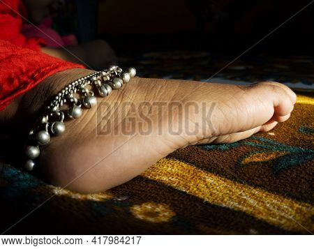 Close Shot Of Indian Girl Child Ankle Chain Isolated On Barefoot