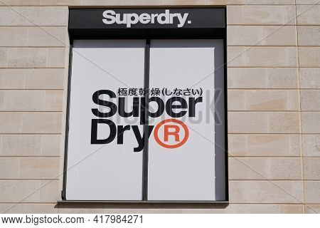 Bordeaux , Aquitaine France - 04 22 2021 : Superdry Logo Brand And Japanese Text Sign Shop Of Store