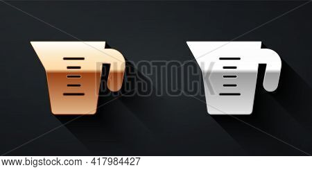Gold And Silver Measuring Cup To Measure Dry And Liquid Food Icon Isolated On Black Background. Plas