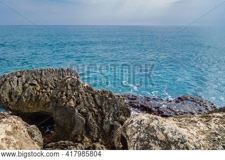 View Onto Rocks Near Sea Coastline. It's Very Typical View For Mediterranean Coastline, Untouched By