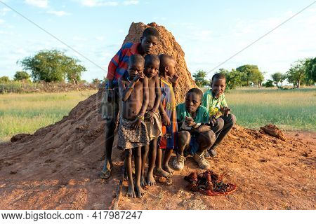 Namibia, Omusati Region, May 7: The Himba Ethnic Boys With African Boys In Early Cold Morning Posing