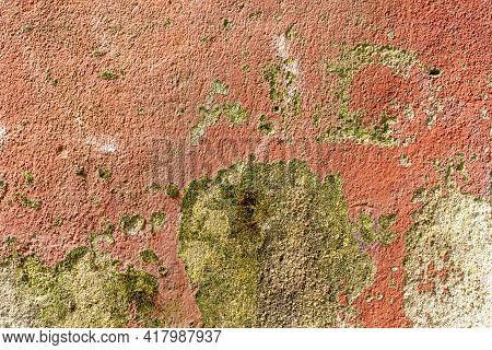 Mottled Textured Painted Peeling Cement Old Wall With Stains Of Peeled Paint