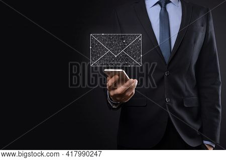 Businessman Hand Holding E-mail Icon, Contact Us By Newsletter Email And Protect Your Personal Infor