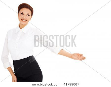 Beautiful graceful smiling professional woman pointing with her hand back into the frame towards blank copyspace isolated on white