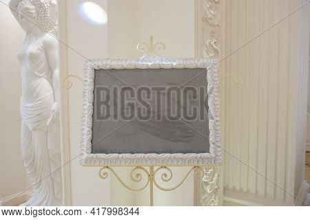 A Wonderful Sculpture And A Wall For Photos In A Banquet Hal, White Color Dominatesl